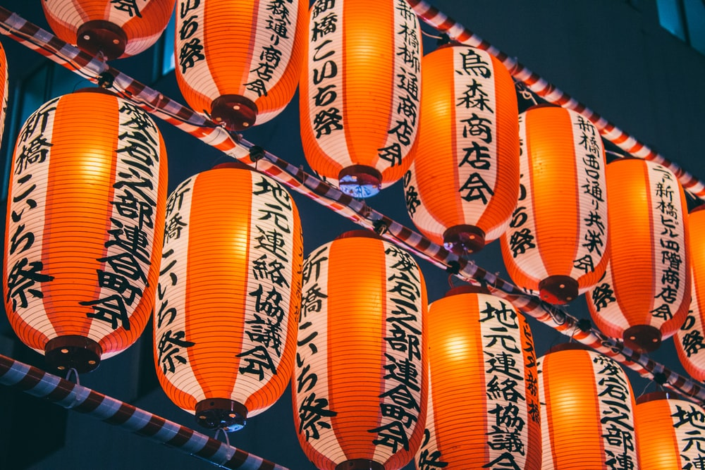 orange paper lanterns on black metal frame