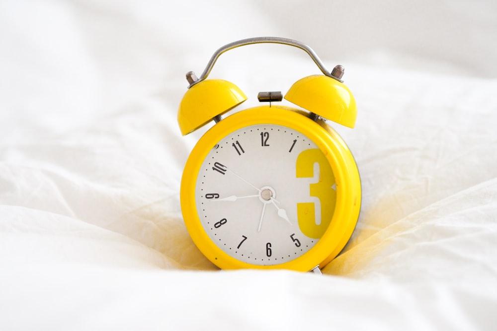 yellow and white alarm clock