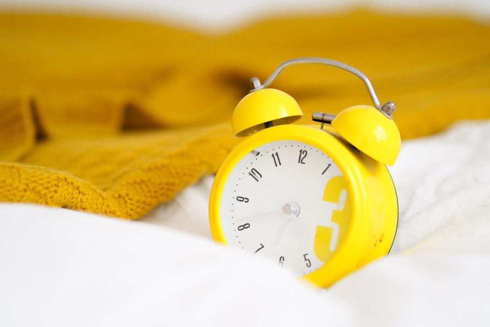 yellow alarm clock at 10 10