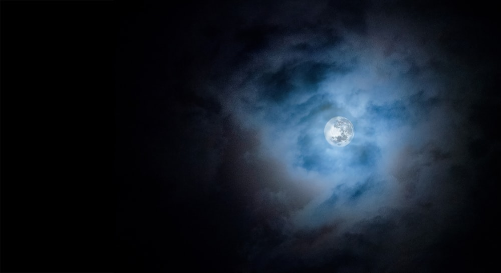full moon covered by clouds