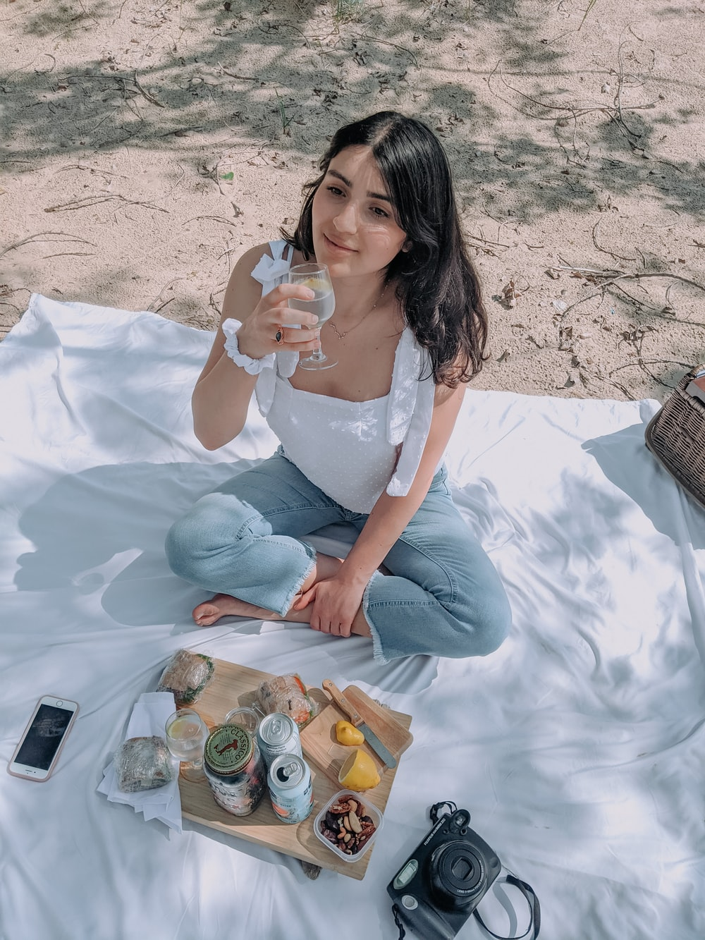 woman in white dress sitting on white textile