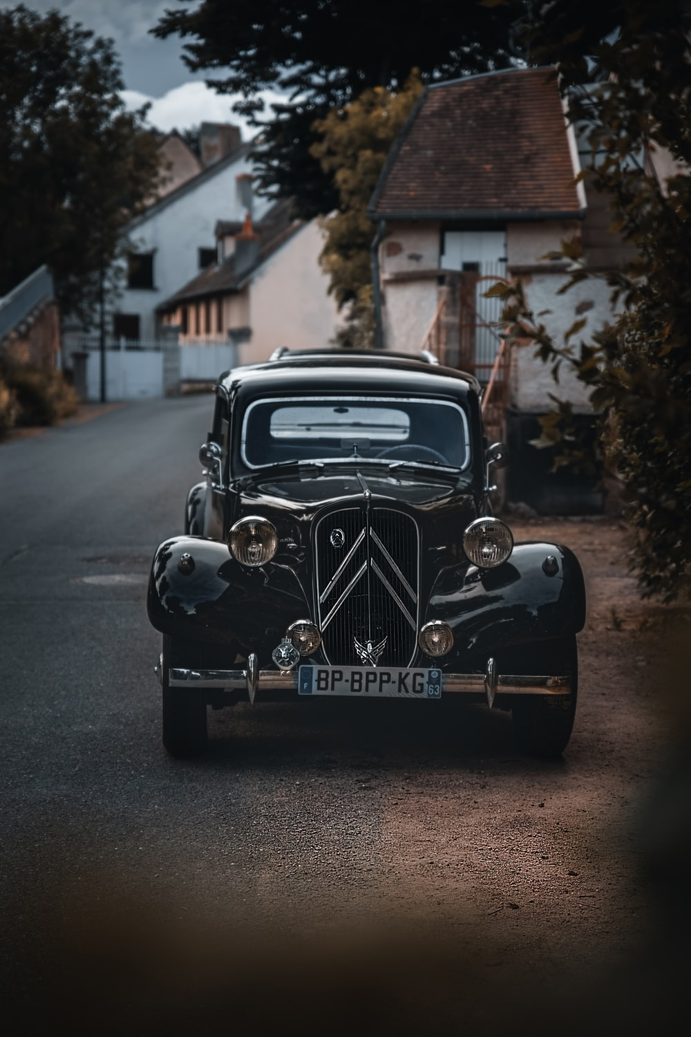 black vintage car parked on the side of the road during daytime