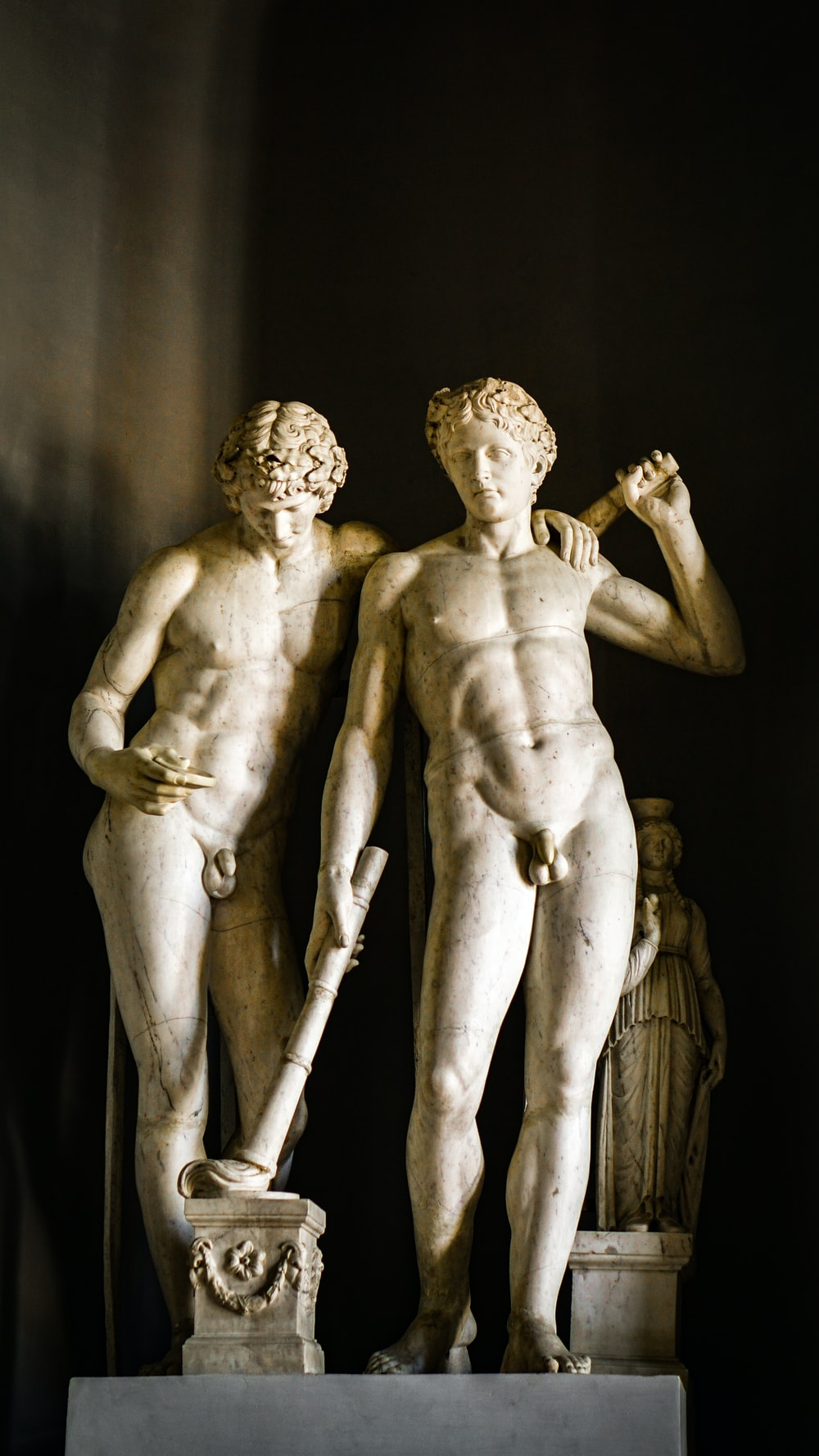 topless man and woman statue