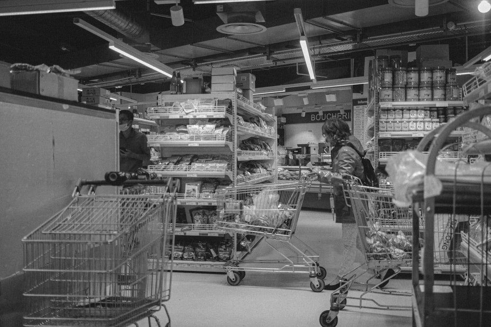 grayscale photo of shopping cart