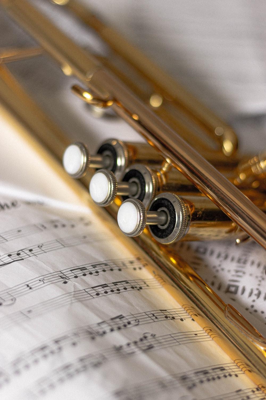 brass trumpet on musical sheet