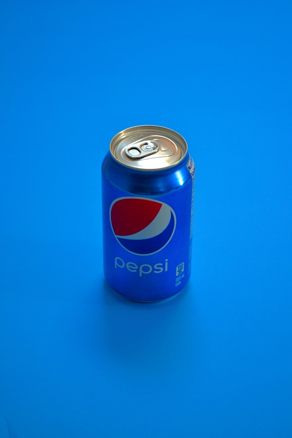 pepsi can on blue surface