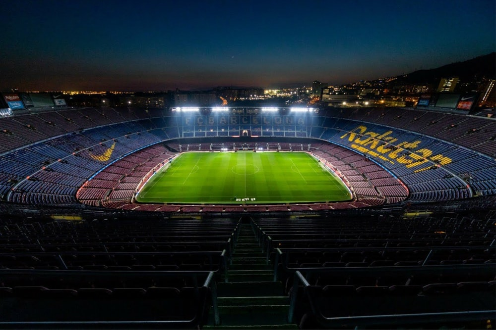 stadium with lights turned on during night time