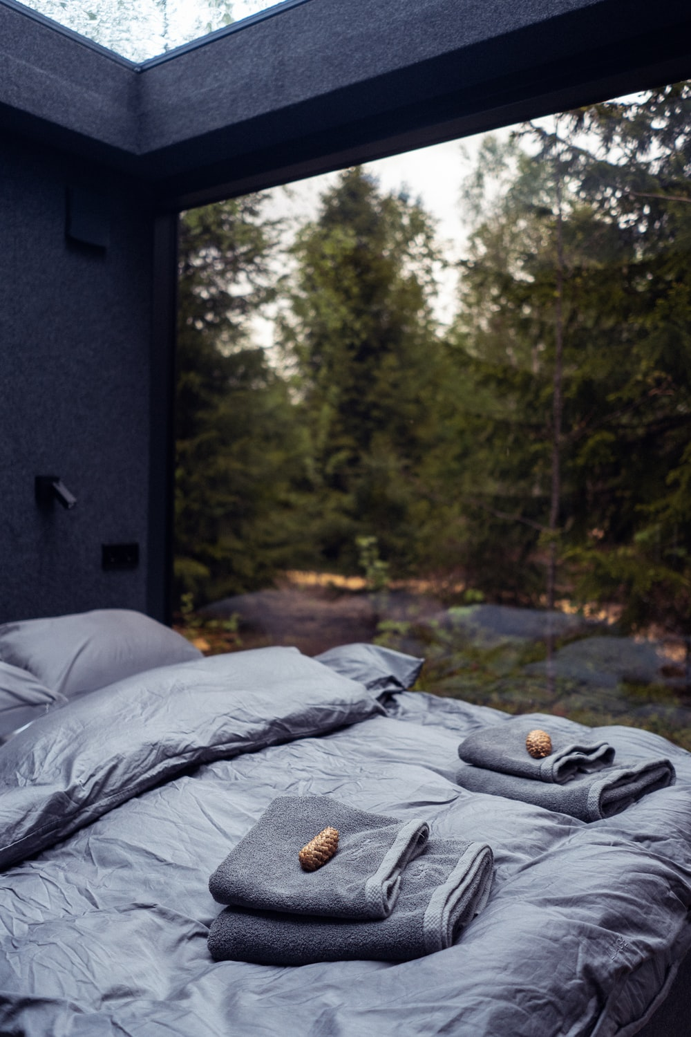 black bed with gray bed linen
