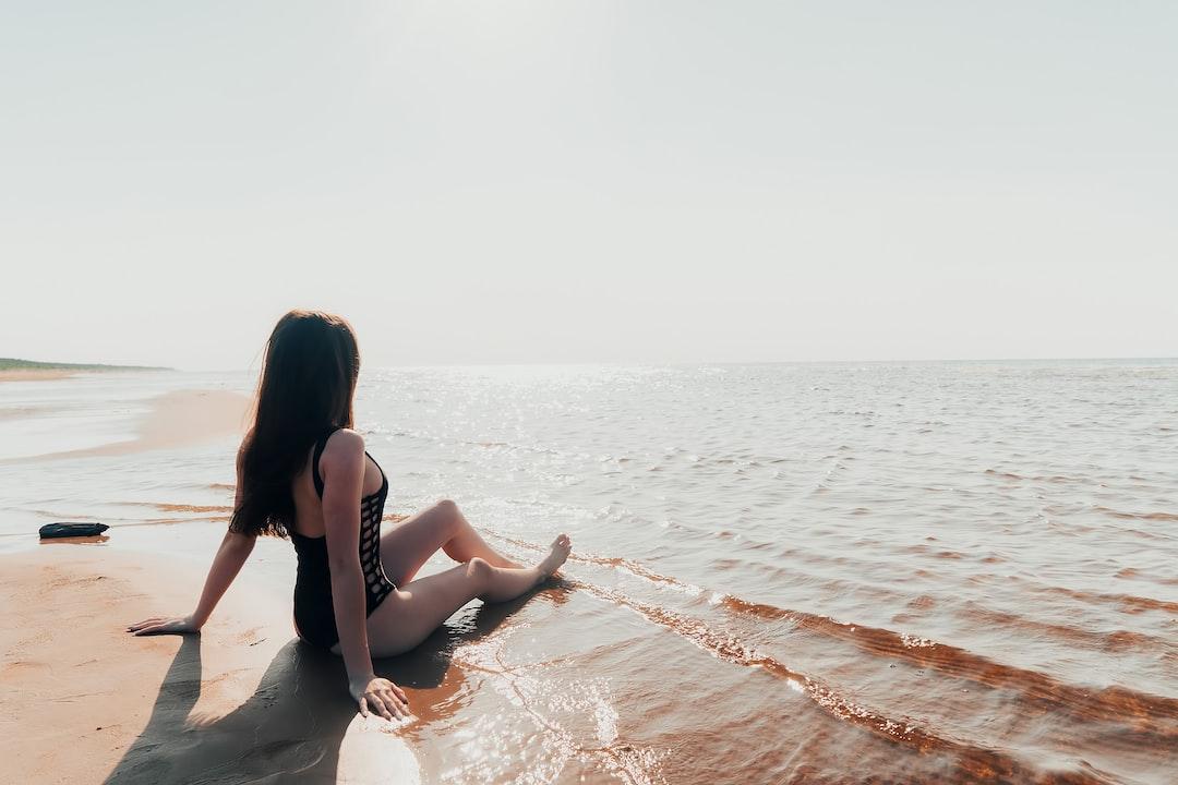 sexy girl in bikini relaxing at the beach