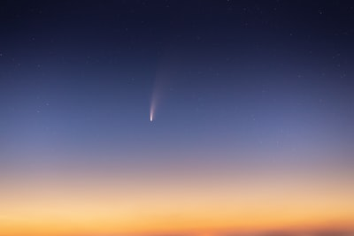 sun setting over the horizon comet zoom background