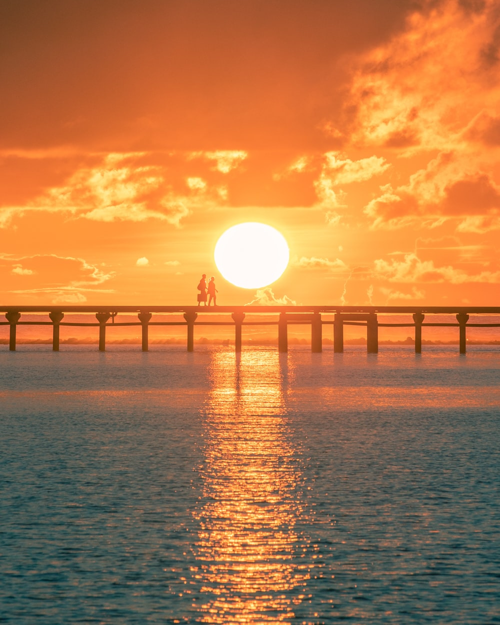 bridge over the sea during sunset