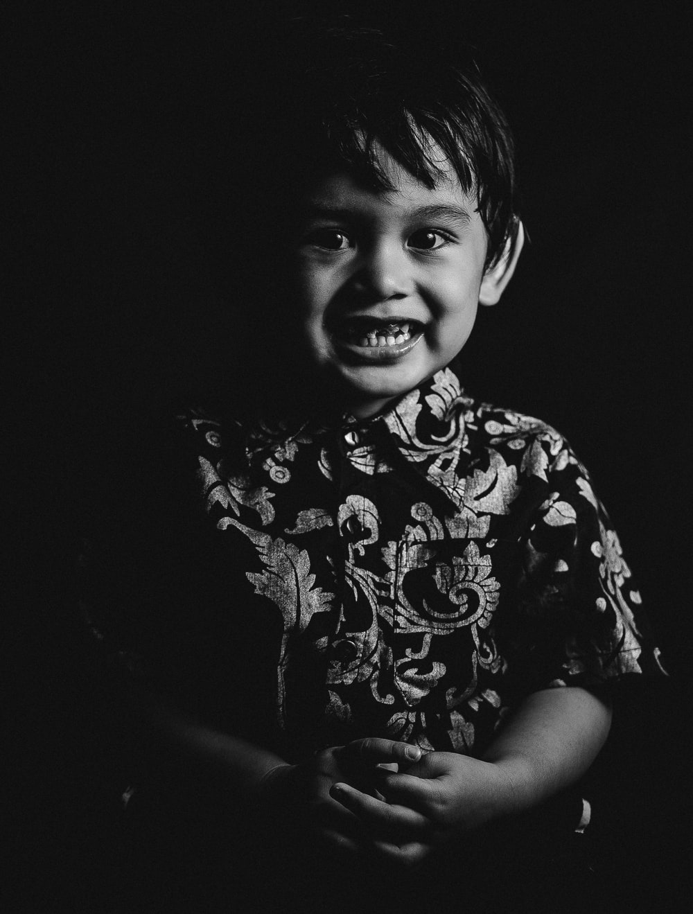 grayscale photo of smiling boy