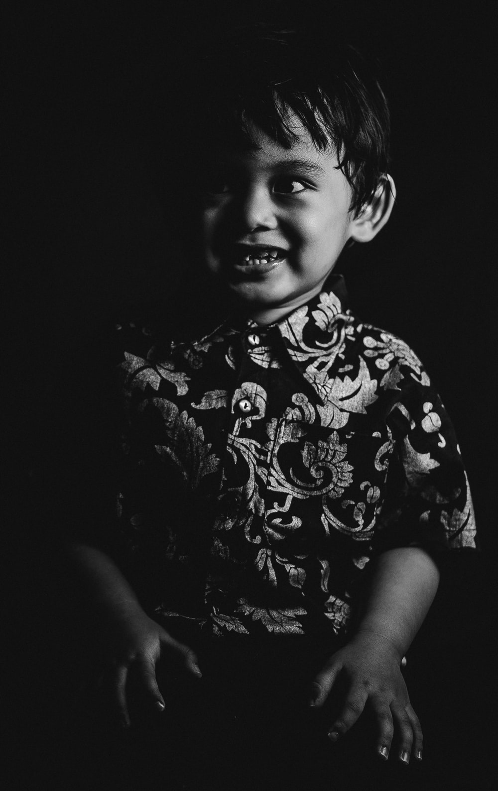 grayscale photo of boy in crew neck t-shirt