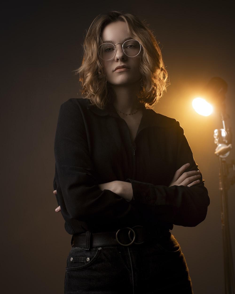 woman in black long sleeve shirt wearing eyeglasses