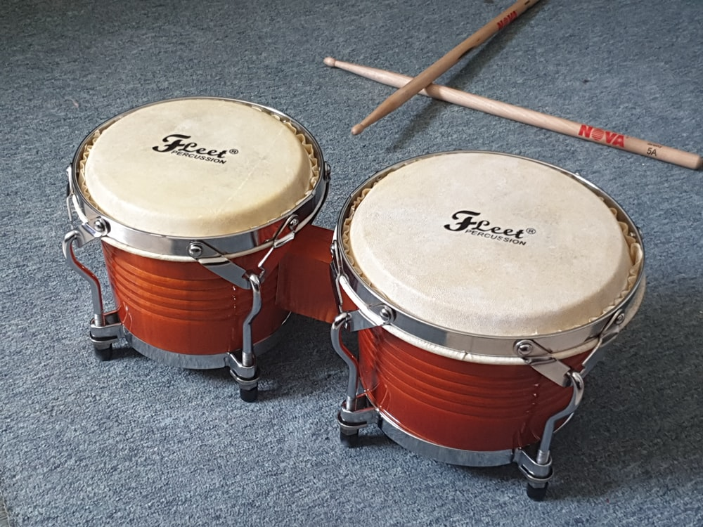brown and white drum set