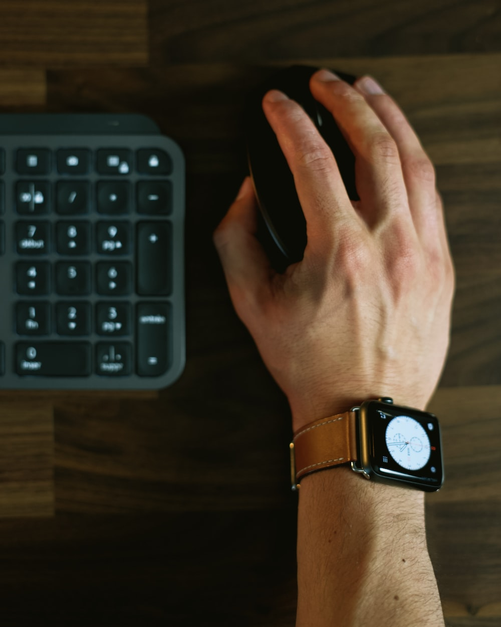 person wearing black and silver apple watch
