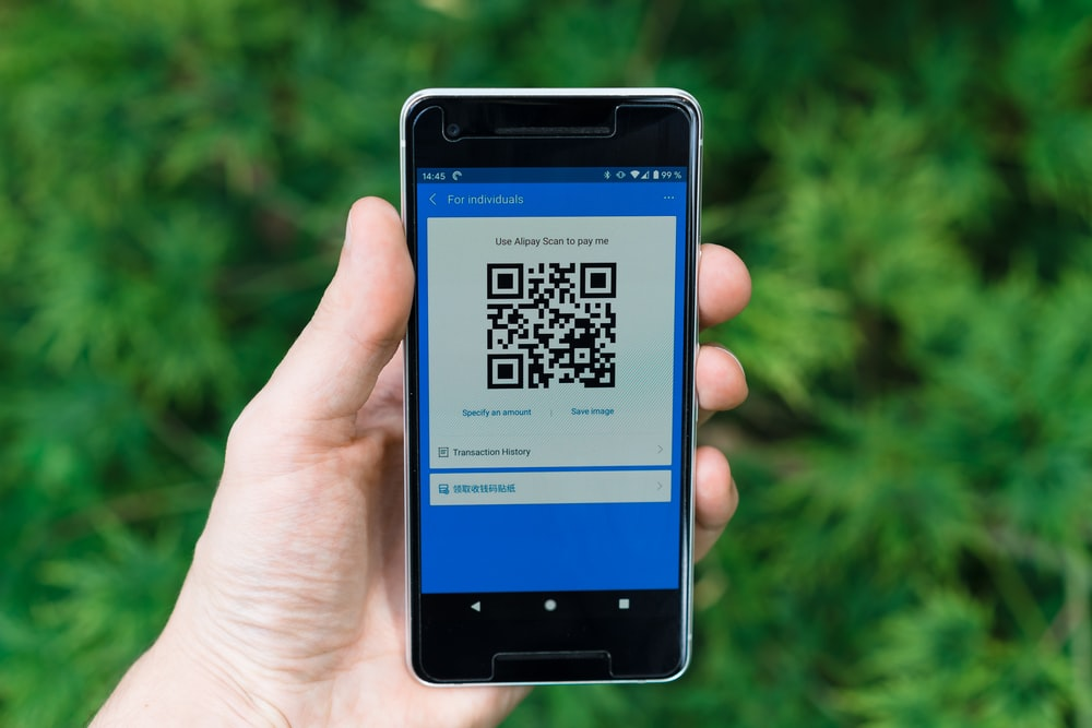black samsung android smartphone displaying qr code