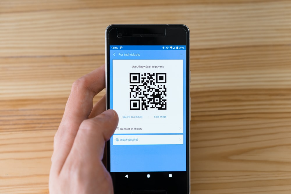 black android smartphone displaying qr code