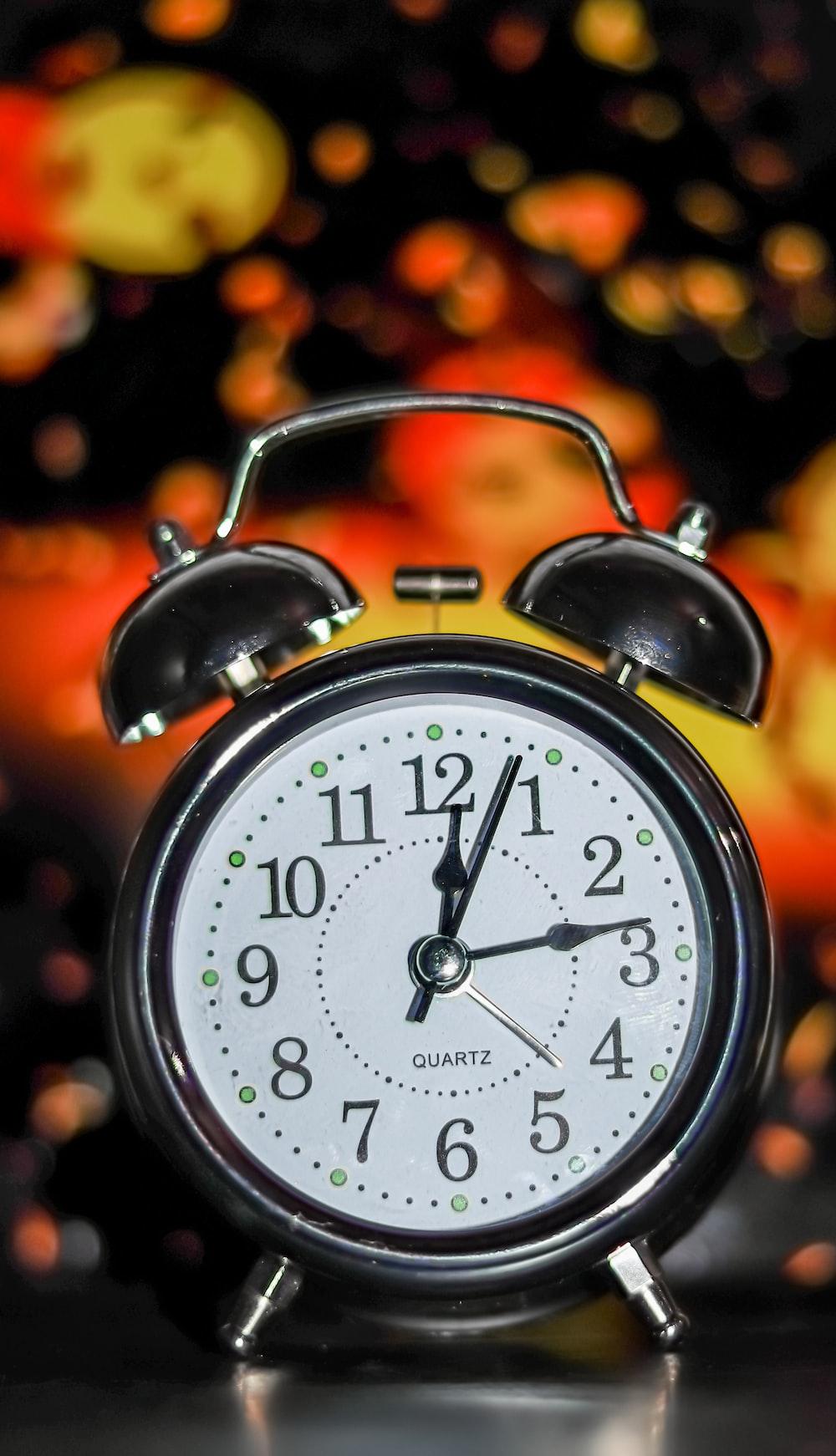 white and black alarm clock at 10 10