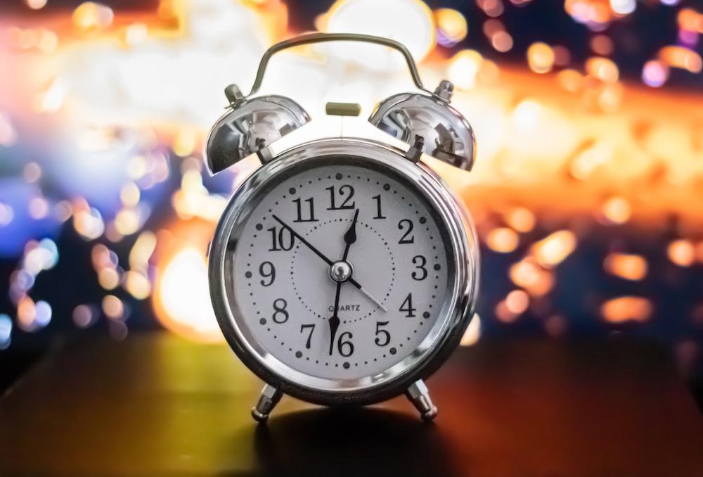 black and white alarm clock at 10 10