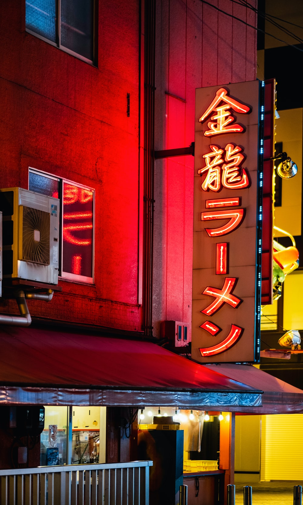 red and yellow love neon light signage