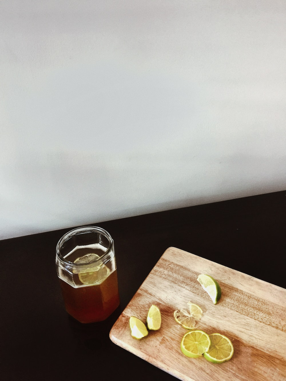 clear glass jar on brown wooden chopping board