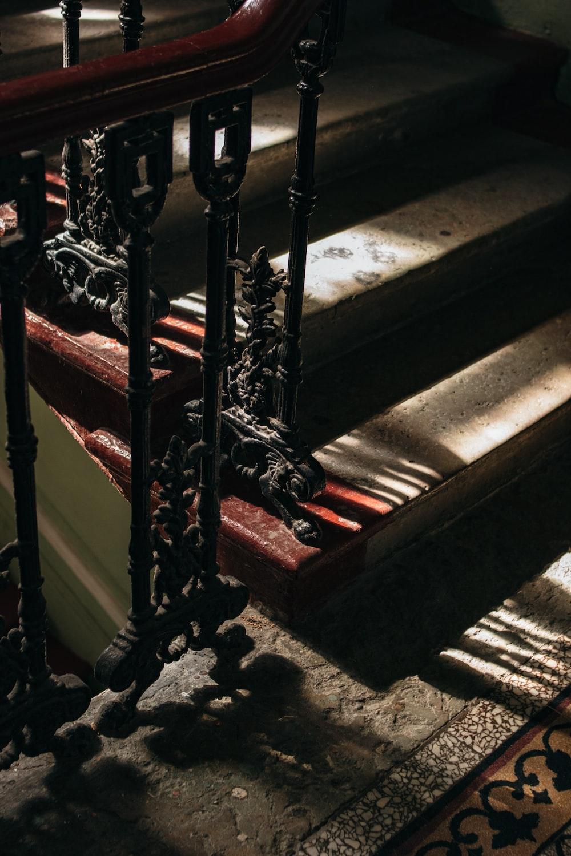 black metal staircase railings on gray concrete staircase
