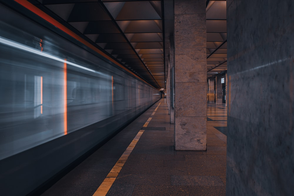 train station with lights turned on during night time
