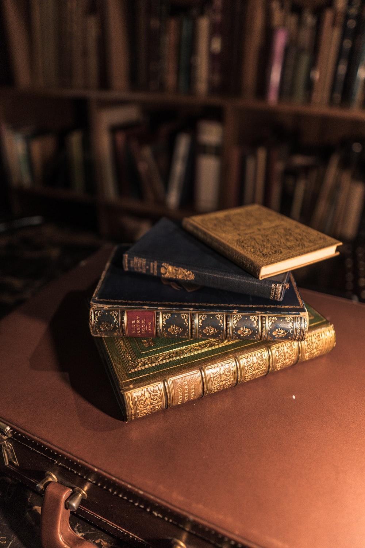 brown hardbound book on brown wooden table