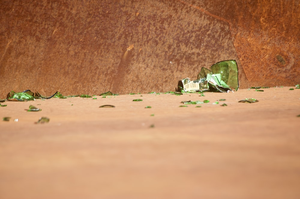 green and white textile on brown sand