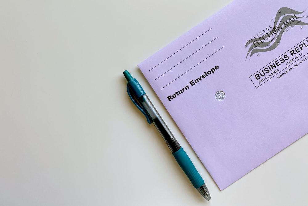 blue click pen on white printer paper