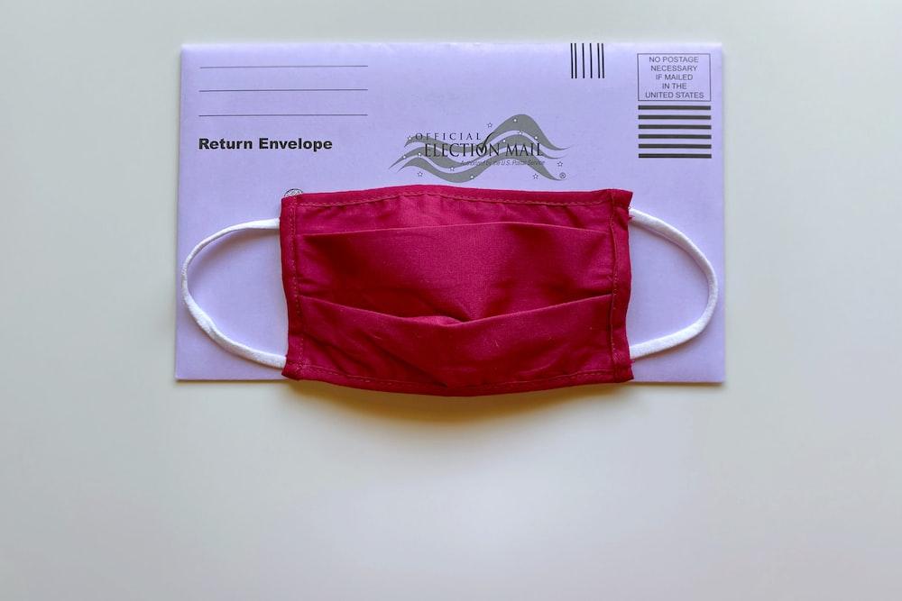 red and white drawstring bag