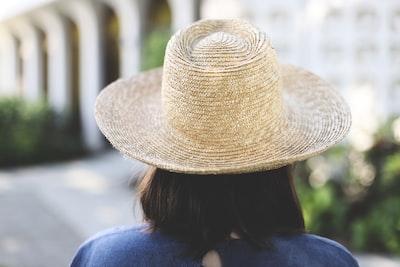 woman in blue shirt wearing brown straw hat greek revival zoom background