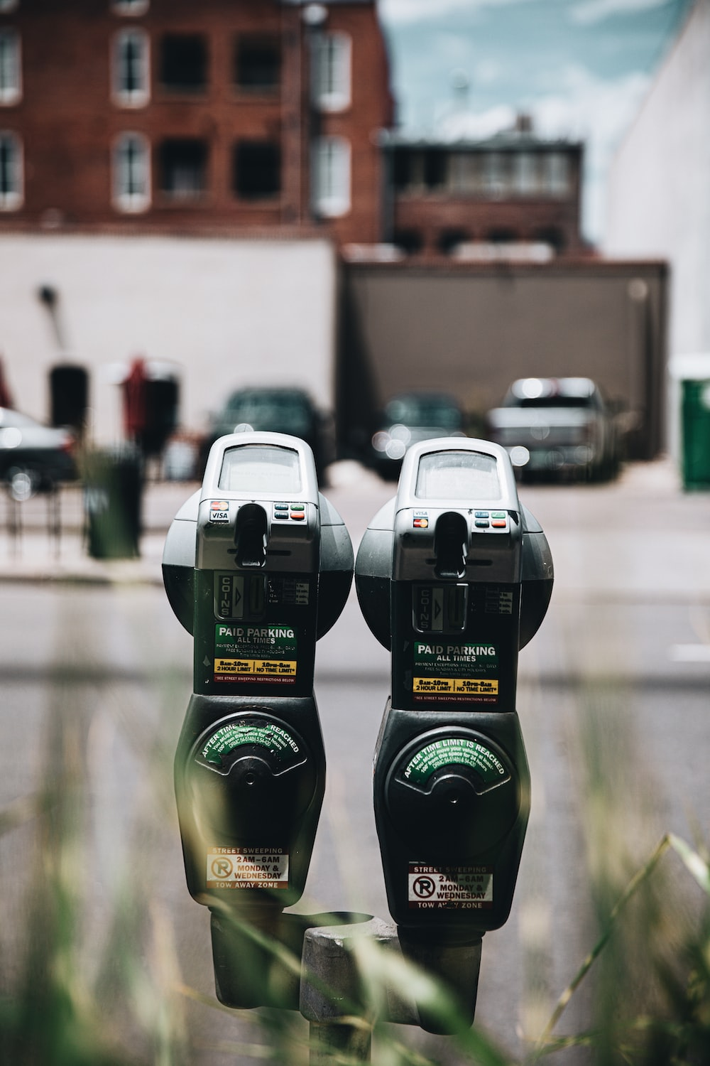 2 green and black parking meter