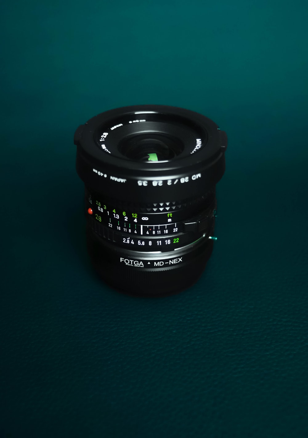 black camera lens on green surface