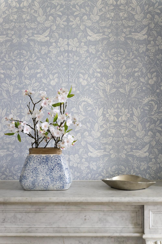 white and blue floral ceramic vase