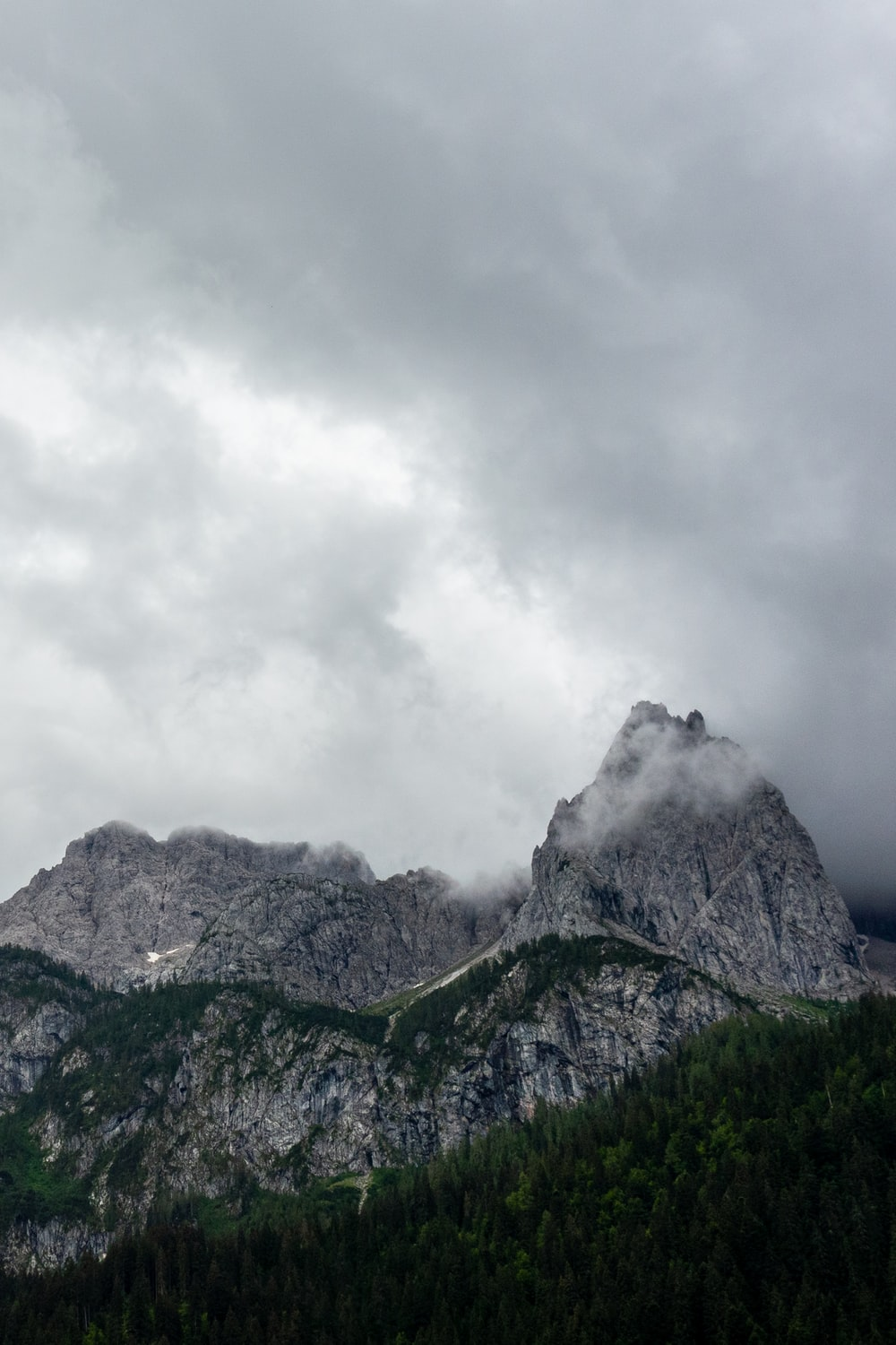 green and gray mountain under white clouds