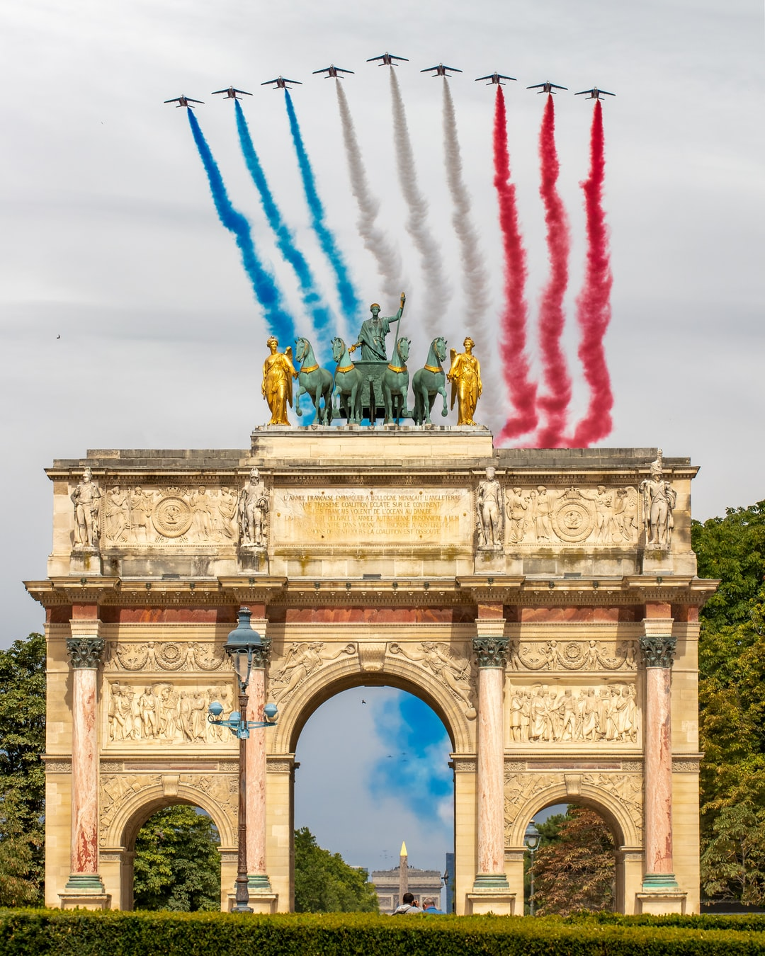 The Arc de triomphe du carrousel with the French Acrobatic Patrol on Bastille Day
