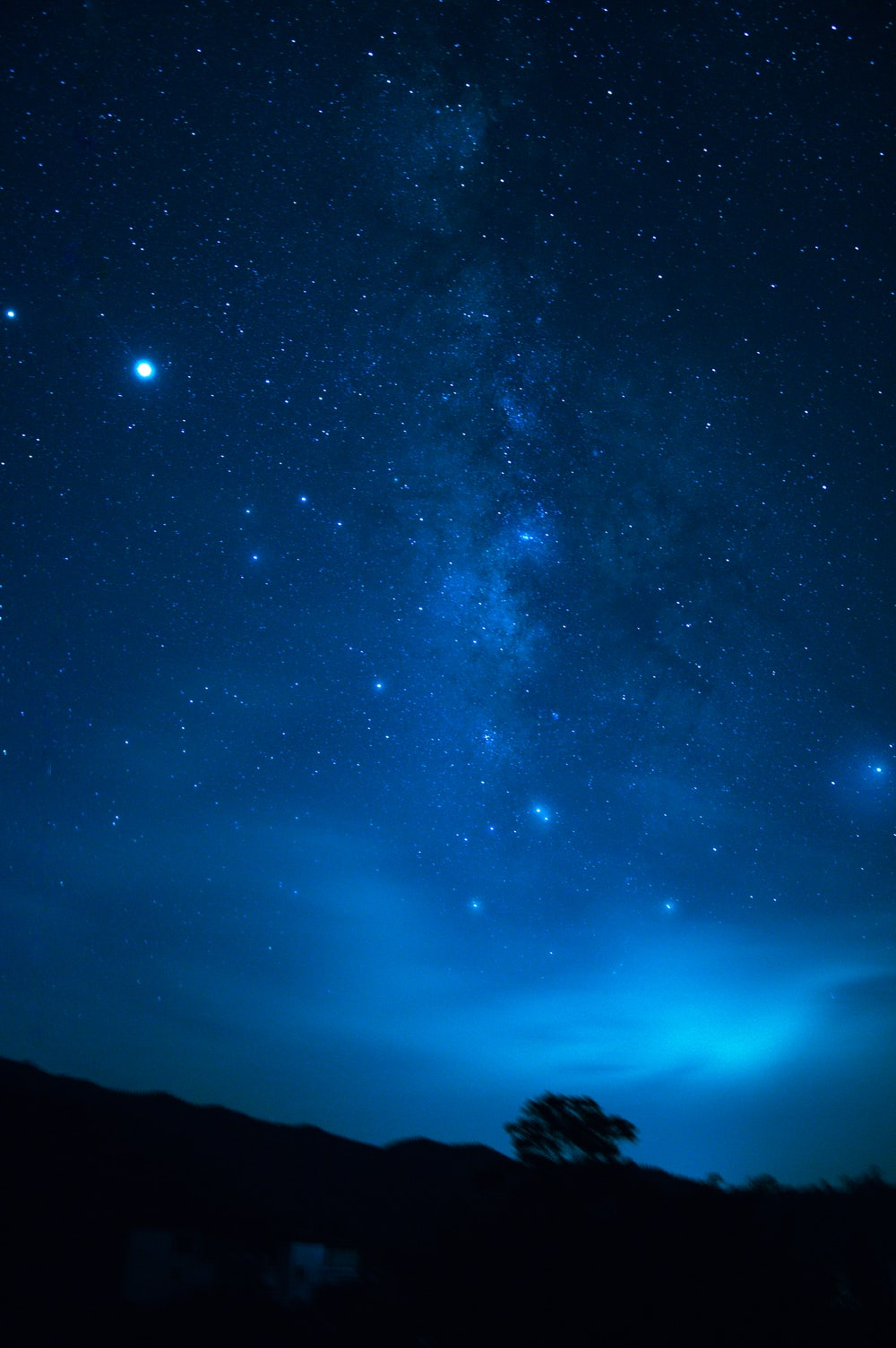 Blue Night Sky Pictures Download Free Images On Unsplash Calm house under night sky shooting star