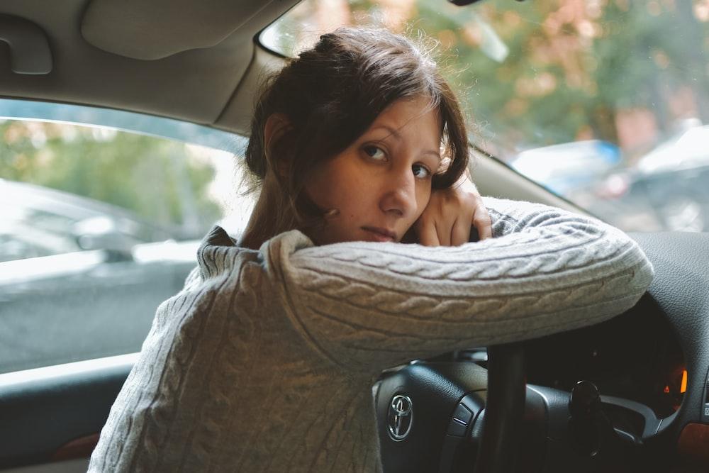 woman in brown scarf inside car