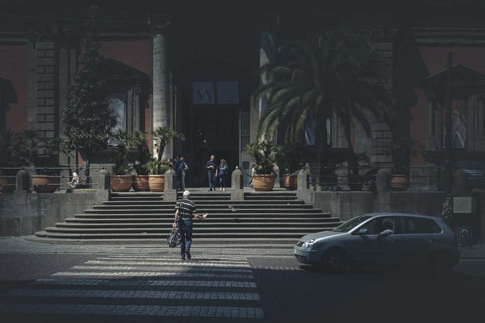 people walking on pedestrian lane during night time