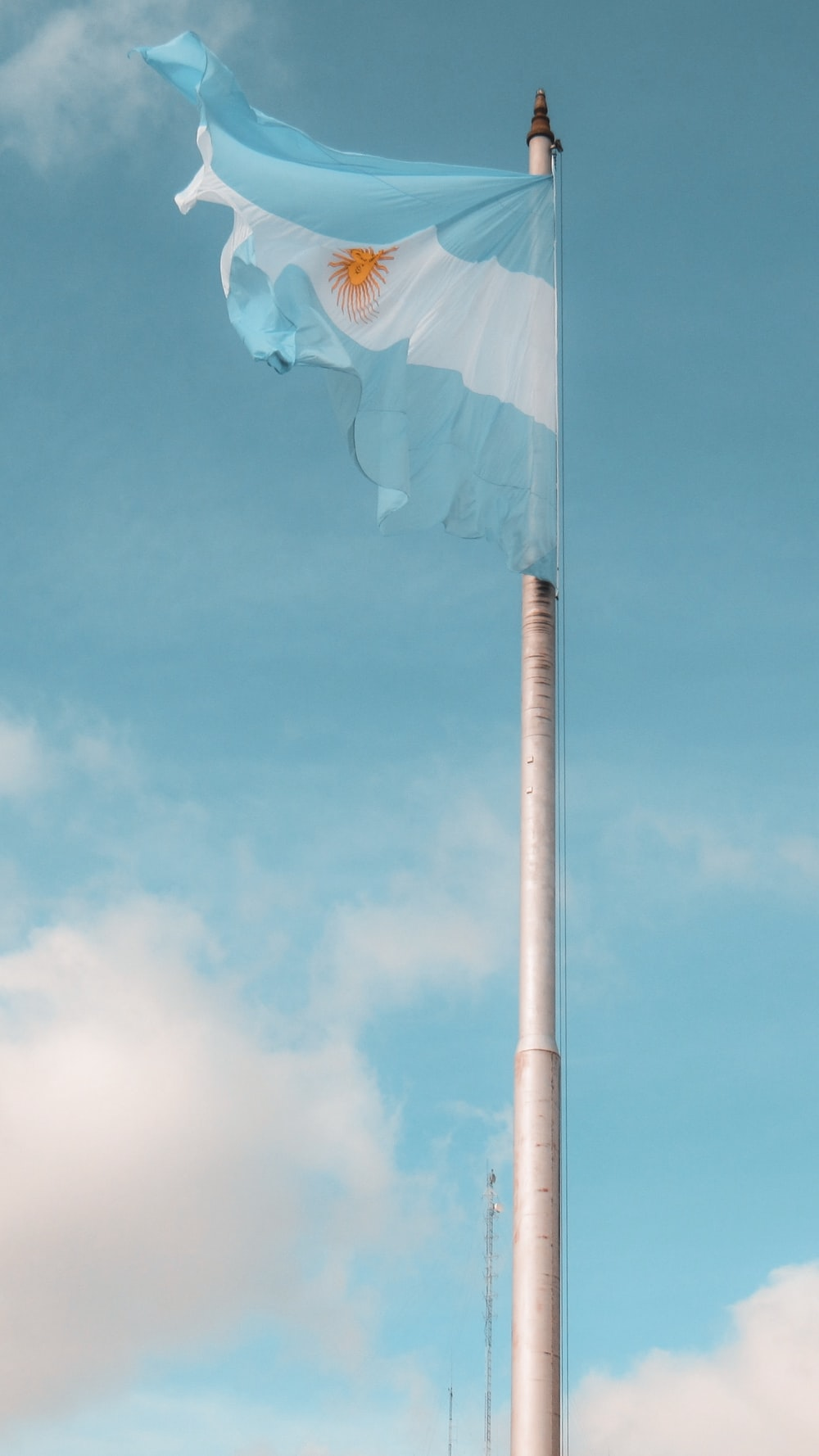 white and blue umbrella under blue sky during daytime