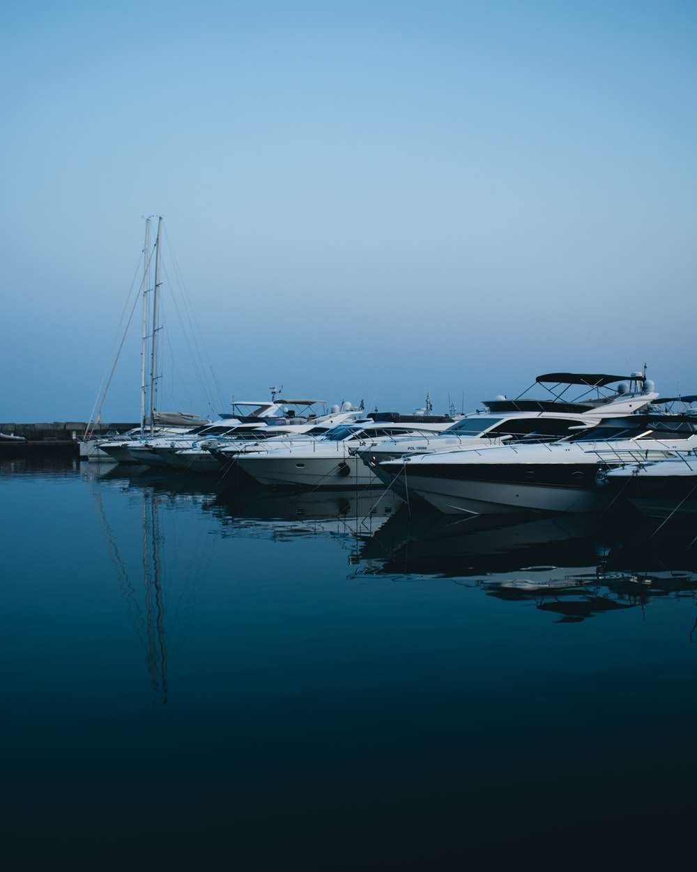 white and gray boats on body of water during daytime