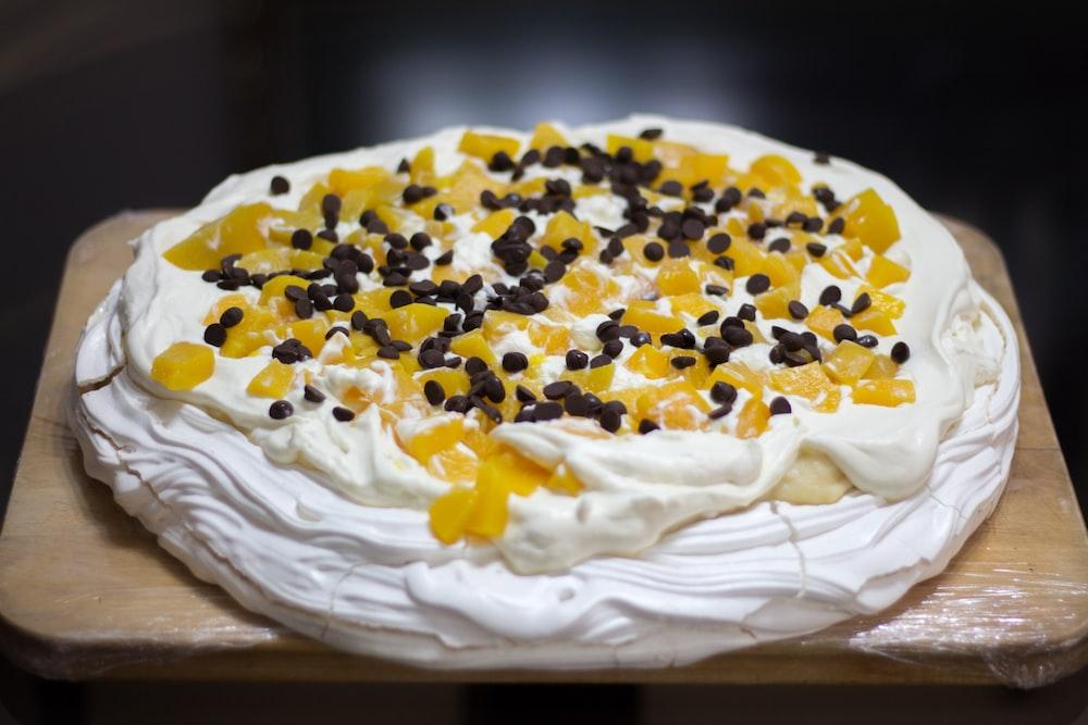 yellow and white cake on white textile
