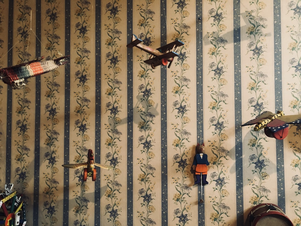 brown and black bird wall decor