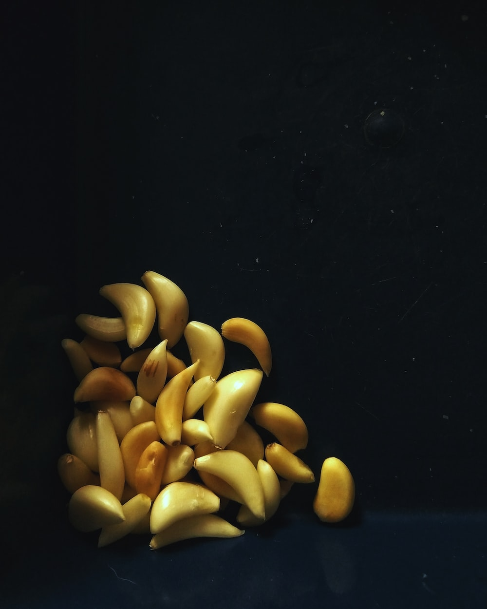 brown nuts on black surface