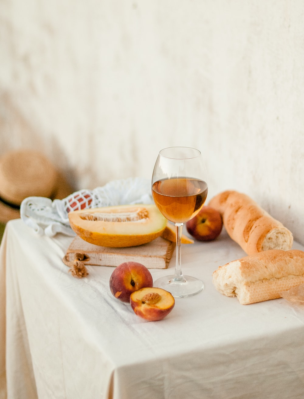 bread and wine glass on table