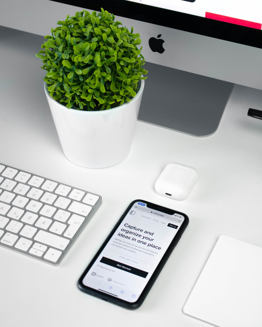 silver iphone 6 beside white apple keyboard