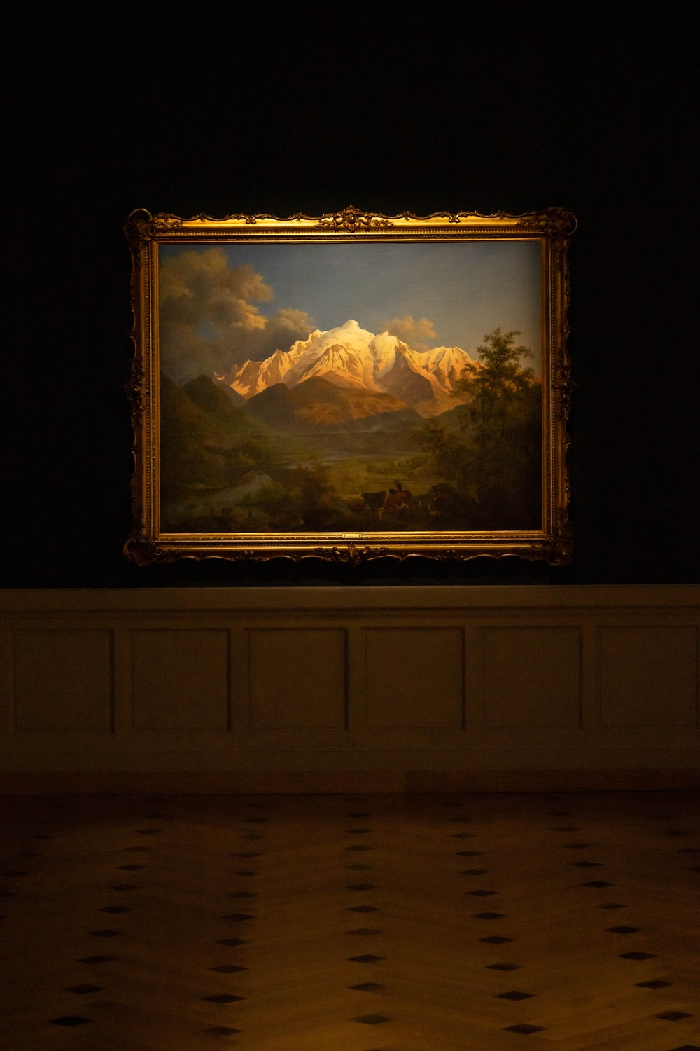brown wooden framed painting of mountains
