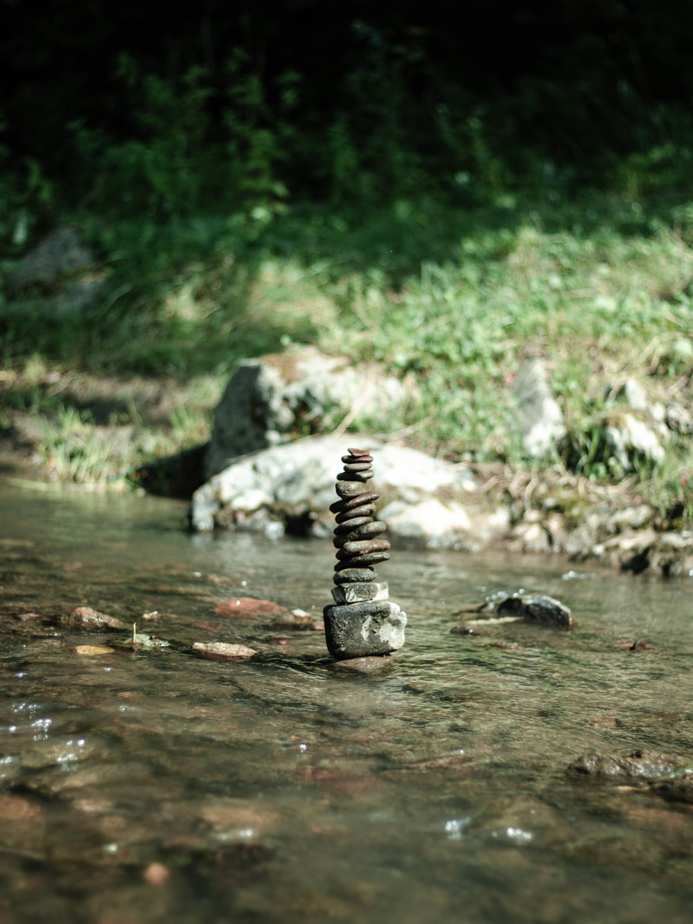 black and gray stones on water